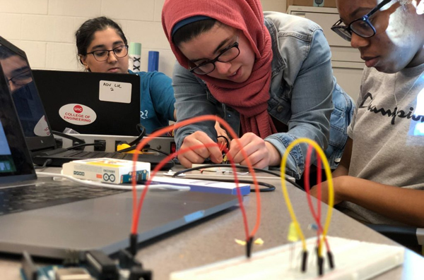 Female students working on engineering project.